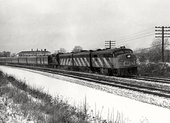 3 CNR cab units and an RS18 speed a late afternoon eastbound VIA train through Toronto's eastern suburbs, en route to Montreal, winter, 1977. (Ivan S. Abrams) Tags: blackandwhite newcastle pittsburgh butler bo ge prr ble conrail alco milw emd ple 2102 chessiesystem westmorelandcounty 4070 bessemerandlakeerie steamtours pittsburghandlakeerie ivansabrams eidenau steamlocomtives ustrainsfromthe1960sand1970s