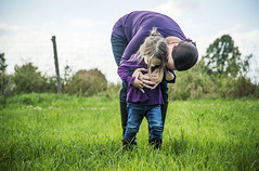A mother catches her daughter and gives her a hug while playing a game in a field (MarleneFord) Tags: family playing game love hugging hug moments play candid daughter mother catch hugs specialmoments