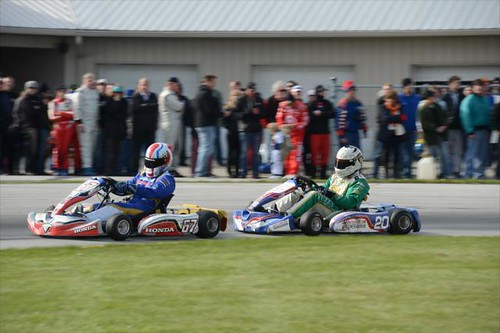 Ed Carpenter chases down the American Honda kart during the Dan