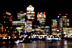 Canary Wharf Bokeh (A-Lister Photography) Tags: lighting city uk light england sky building london silhouette horizontal skyline architecture night docks buildings reflections river landscape lights focus energy cityscape skyscrapers riverside bright employment bokeh citylife dramatic landmark icon business busy citylights electricity softfocus docklands nightlife positive innercity economic canarywharf iconic financial riverthames economy modernarchitecture offices unemployment cityoflondon finance eastend eastlondon businessmen londonskyline officeworkers londonicon wetreflections cityworkers cityphotography iconiclondon adamlister nikond5100 alisterphotography