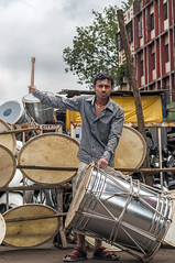 Buy me Drums! (Anoop Negi) Tags: portrait music india photography photo ganesha drum percussion religion culture ganesh drumming tasha anoop seller pune beating beater immersion negi dhol ezee123 vision:people=099 vision:face=099 vision:outdoor=089 vision:sky=0531
