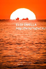 fishing boats in front of sun (Eloi Omella) Tags: travel light sunset red sea sky orange sun sunlight lake seascape reflection tourism nature water colors silhouette horizontal sailboat sunrise outdoors photography fishing spain day sailing pentax dusk candid horizon istockphoto working wave nopeople catalonia istock dramaticsky vacations costabrava mediterraneansea stratosphere k5 distant frontview palamós platjadaro traveldestinations colorimage beautyinnature microstock tropicalclimate horizonoverwater nauticalvessel middistance travellocations