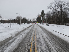Out for a drive on a dark morning. (Tim Kiser) Tags: 2016 20160301 capitalregion eastlansing eastlansingmichigan eastlansinglandscape img1579 inghamcounty inghamcountymichigan lansingmetropolitanarea msu msulandscape msustreetscape march march2016 michigan michiganstate michiganstateuniversity michiganstateuniversitylandscape michiganstateuniversitystreetscape michiganlandscape centralmichigan cloudy cloudymorning darkmorning lampposts landscape lightpoles midmichigan middleofthestreet overcast overcastlandscape overcastmorning plowedsnow snow snowremoval snowylandscape snowystreet snowystreetscape southcentralmichigan street streetlights streetscape view winterlandscape unitedstates