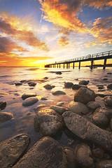 Pier in the sunset (johaennesy) Tags: sunset bodensee lakeconstance friedrichshafen steg stones wide warm clouds gimp rawtherapee