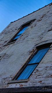 Windows in a brick wall by sheldn Waukesha WI