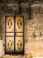 Door #4 (Nidal.Elwan) Tags: door old house art window wall israel doors palestine westbank ramallah nablus jerusalem olympus walls past zuiko israeli  kfar evolt nidal palestinian e500  kufr nidale       s95              elwan qaddum kadum  needoo77