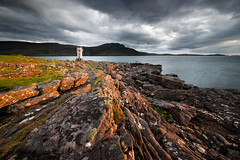 Rhue Lighthouse II (Philipp Klinger Photography) Tags: ocean uk greatbritain blue light sunset sea vacation orange sun lighthouse house mountain holiday storm mountains cold water yellow rock reflections dark island islands scotland high
