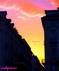 in centro a torino (archgionni) Tags: sunset sky italy orange birds clouds buildings square torino italia tramonto nuvole uccelli cielo piazza turin arancione edifici itswritteninthestars
