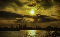 Gold Spread (_Amritash_) Tags: travel london silhouette skyline clouds gold dock cityscape wide skyscrappers rays nikkor sunrays cpl shimmer rayoflight westferry sunsetovercity silhouettedcity nikond7000 amritash westferrydock goldspread