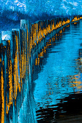 Blue and Gold (fstop186) Tags: blue sunset sky orange abstract blur texture water colors lines contrast sunrise canon reflections landscape gold glow shadows timber infinity curves surreal complementary moonlight 5d goldenhour leadinglines vividimagination canonef24105mmf4lisusm awardtree vision:text=052