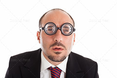 Who are you? (Dario Lo Presti) Tags: white male nerd businessman lens fun glasses bigeyes interesting funny humorous different geek unique humor young business suit whitebackground round concept manager confusion thick isolated fool foureyes eyewear eyesight caucasian uncertainty attire lookingatcamera nearsight diopters pooreyesight aquula