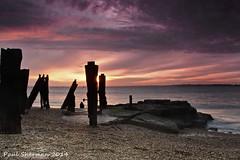 Another Day Ends (muppet1970) Tags: sunset sea beach water docks landscape suffolk sand woods rocks stones pebbles northsea felixstowe oldjetty landguard