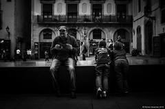 Interests (Rense Haveman) Tags: barcelona street people bw man boys sunglasses book balcony streetphotography jeans rest gazing pentaxk5 rensehaveman