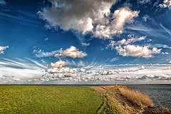 A Very Big Sky (Alfred Grupstra) Tags: blue dike sky clouds ijselmeer lake landscape water lelystad flevoland nederland nl nature cloudsky summer outdoors ruralscene scenics cloudscape beautyinnature sea grass sunlight meadow horizon field sun nonurbanscene