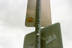 00390018 (alexdotbarber) Tags: 14000 35mm c41 houston houstonmidtown houstonstreetart kodak kodakportra400 nikon nikon50mmf14afd nikonfm3a slr colornegative f4 manualfocus sidewaysface smileyface
