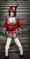Mad Moxxi. (Iacobus Images) Tags: red playing game photography nikon cosplay stripes steps feathers fishnet ring master card gamer heels cosplayer cleavage vr queenofhearts 18105 loveheart borderlands d90 yongnuo square43 moxxi madmoxxi gamilight 560ii replayretrorevival