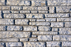 background of textured stones in a wall (Mimadeo) Tags: old wallpaper abstract brick texture rock stone wall architecture construction pattern background surface structure block rough textured