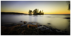 Island on lake Nsijrvi, Tampere (Olli Tasso) Tags: longexposure sunset lake blur yellow rock suomi finland landscape island still scenery calm tampere maisema hoya jrvi auringonlasku saari nd400 nsijrvi pirkanmaa valotus toimela tapatora
