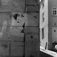 Look Back (DanRSmith) Tags: street blackandwhite bw art 120 tlr mediumformat square graffiti stencil squareformat hastings oldtown yashica 1x1 yashicamat rollfilm