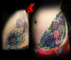 Colorful Flower Cover-up Tattoo by Jackie Rabbit (Jackie rabbit Tattoos) Tags: california ca city flowers flower color sexy up tattoo nude star virginia cool colorful lotus good girly awesome great pussy violet stomach cover roanoke va lilly daisy rib chico hip coverup jackierabbit eyeofjade