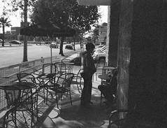 Outside Starbucks Leica Z2X (Digital Film Photography) Tags: life california street leica city urban white black film coffee shop 35mm vintage concrete photography al lomo lomography kodak starbucks jungle tables and epson v600 pasadena seating expired fresco z2x bw400cn