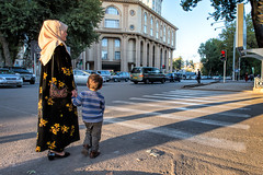 Mother and child wait to cross street (damonlynch) Tags: city family boy people woman male kids female children person parents persian women waiting asia masculine feminine muslim islam religion mother hijab son streetscene busy parent human lad wait intersection iranian tajikistan dushanbe tajik protective centralasia protection humanbeing youngman humans protect humanbeings preschooler centralasian womanly districtsofrepublicansubordination