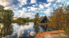 Autumn on the Norfolk Broads (Steve Docwra (Norfolk based photographer)) Tags: autumn trees water reflections river countryside boat norfolk boathouse eastanglia moorings norfolkbroads howhil vision:mountain=0599