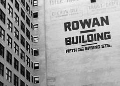 Rowan Building (blueverbena) Tags: blackandwhite bw losangeles pershingsquare 50mmf14 vision:text=0537 vision:sky=0503 vision:outdoor=0953 vision:street=0555