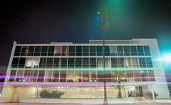 Multi-purpose Building (Space-wanderer) Tags: california longexposure film night canon losangeles streetlights f1 palmtree lighttrails southerncalifornia koreatown larchmont wilshireboulevard windsorvillage