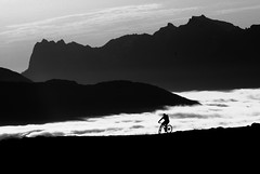 Cloud riding above Tromsø (Snemann) Tags: mountains monochrome norway august silouette mountainbiking k5 tromsø justpentax