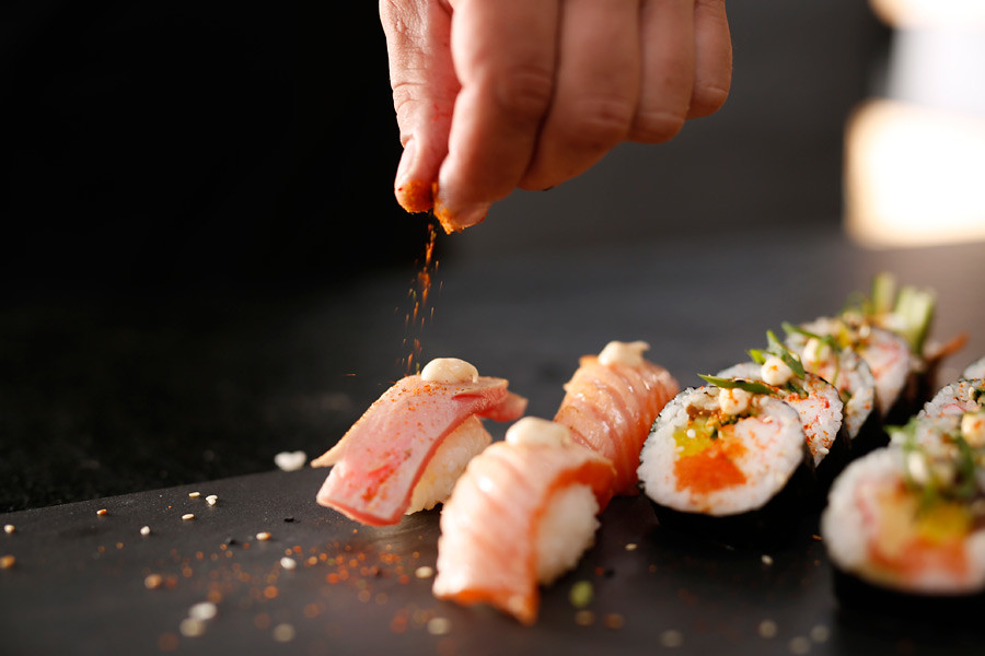 Sushi chef preparing a meal at an upmarket restaurant