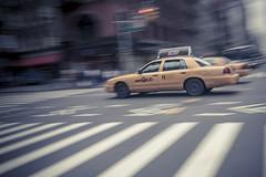 NA_Biketour_2009_090 (jkiralyphotography) Tags: nyc newyorkcity newyork blur speed traffic taxi busy motionblur panning