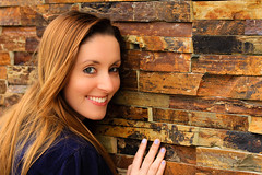 A Textured Portrait (Bartfett) Tags: red portrait orange cute brick texture face yellow wall eyes focus pretty glowing sharpness