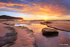 Turimetta Reflections - Sydney - Australia (Jarrod Castaing) Tags: ocean morning travel blue sunset red sea summer wallpaper sky cloud sun seascape color reflection art tourism beach nature water beautiful beauty sunshine stone sunrise print landscape photography dawn bay coast photo sand scenery colorful surf glow tour view natural outdoor head fine sydney scenic peaceful wave australia scene workshop shore nsw beaches tropical jarrod coastline northern tranquil narrabeen headland castaing turimetta