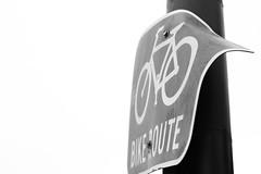Bent Up (renegi23) Tags: california urban blackandwhite streets bike sign metal canon rebel 50mm prime berkeley decay bikes bayarea fixed roadsign bikelane bent rebelt3i canoneosrebelt3i