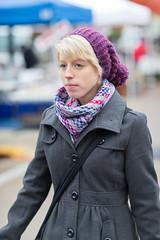 Staying warm (ibm4381) Tags: portrait girl pretty farmers market candid madison canonef85mmf12liiusm
