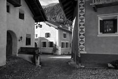 streets of Bergün (Toni_V) Tags: bw monochrome schweiz switzerland blackwhite europe suisse rangefinder svizzera m9 graubünden grisons albulatal svizra sep2 bergün summiluxm 2013 grischun 35mmf14asph bravuogn niksoftware 35lux 131026 ©toniv leicam9 l1014349