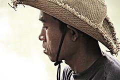 Papa Piang - Don Det - Laos (Asia Trip Tour - Sbastien Pagliardini) Tags: boy portrait island cow cambodge riviere du vietnam national chapeau don asie laos pcheur mekong geographic sud det est thailande fleuve 4000 iles pche indonsie