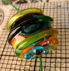 Jolie (Laura Blanck Openstudio) Tags: show blue orange usa black green art glass grass lines yellow coral giant spiral cord necklace beads big shiny colorful aqua published artist european bright handmade turquoise unique steel stripes fine arts chartreuse dramatic style wrapped funky jewelry charm bumpy holes made odd mango round winner huge troll lime transparent mermaid dots kiwi kiln pandora murano rare maize lampwork multicolor artisan pendant choker stainless torched bold whimsical raised petroleum singe openstudio biagi focal annealed openstudiobeads