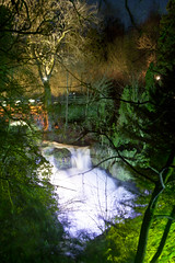 Rouken Glen lights 5 (Unh@ppyb@st@rd) Tags: park uk longexposure trees color water lights scotland waterfall colours dreamy roukenglen