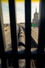 train (sallypuma) Tags: newyork building film train 35mm nikon bars albany 100 28 24mm ais ektar filmisnotdead smalbany