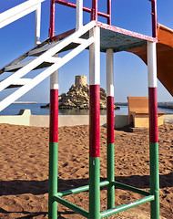 Playful, and a fort too. (PuzzleMonkey!) Tags: beach playground shoes fort middleeast arab arabia oman playgroundequipment abandonedshoes quriyat beachfort nationalcolours quriat