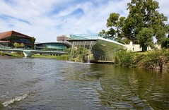Adelaide. The Convention Centre, the River Torrens and the fountain which splutters out of the end of the new glass footbridge (denisbin) Tags: adelade bridge footbridge torrensriver adelaideoval fountain conventioncentre