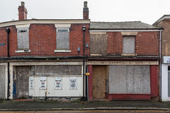 The Chronical (Gary Kinsman) Tags: highstreet crewe cheshire 2017 canon5dmkii canoneos5dmarkii canon28mmf18 urban urbanlandscape grey overcast clouds abandoned derelict unplace nowhere banal mundane architecture grim newtopographics topographics victorian boardedup thechronical terrace terraces terracedhouses shops wcarrollson postindustrial decline localnews