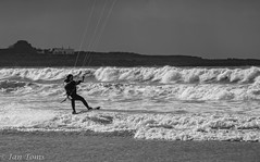 Kite Surfer bnw (Ian Toms) Tags: kitesurfer action guernsey landscape winter vazon guernseylife mono sea kite man beach wind waves visitguernsey surf sunlight sealife blackandwhite guernseystyle sand board bnw kitesurfers