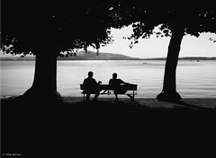 enjoy spring (René Mollet) Tags: spring frühling zug zugersee lake lakefront trees man old young blackandwhite blackwhite bw street streetphotography shadow silhouette renémollet monochromphotographie monochrom streetphotographiebw zuiko penf