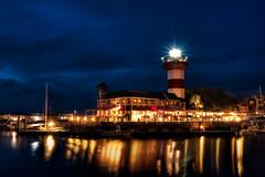 Harbour Town Lighthouse (JustinDustin) Tags: lighthouse water night marina boats island twilight dock lowlight nikon dusk southcarolina processed hiltonhead hdr d600 harbourtown photomatix cs6 2013