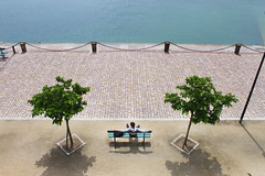 (harryharryg) Tags: blue trees shadow sea france colour green water st fence bench french sand chair seat symmetry cobbles malo