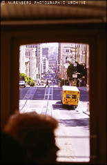 WmN#0113-00017 Streetcar View San Francisco 1985 (Nurenberg Photographic Archive) Tags: sanfrancisco california bridge people usa signs streets cars water marina boats chinatown ships streetphotography trains goldengatebridge isabel sanfranciscobay 1980s frisco businesses streetcars williamnurenberg