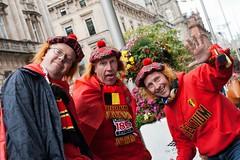 Crazy Belgians (Leanne Boulton) Tags: life street city red people urban black color colour men yellow scotland belgium glasgow candid group belgian